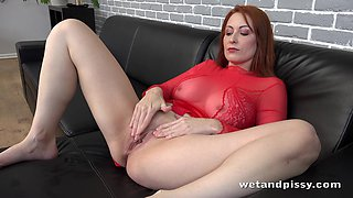Curvy ginger MILF Isabella Lui loves piss play and she masturbates a lot
