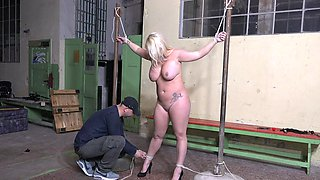 Busty blonde slave Lilith Lee enjoys getting pleasured with a vibrator