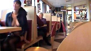 Busty babe flashing in a restaurant
