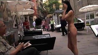 Slender brunette babe exposes her naked body on the street
