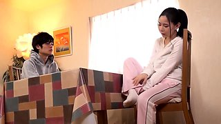 Stacked Oriental housewife sexually satisfied by a masseur