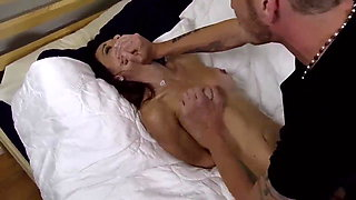 Busty naked brunette tied on bed