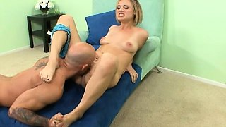 Horny blond hottie gives lover a foot rub while he goes down on her