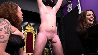 Two dominant amateur milfs punishing their masked slave