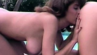 Lesbian threesome at the pool