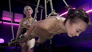 Blonde girl is dominating her tied up Asian slavegirl