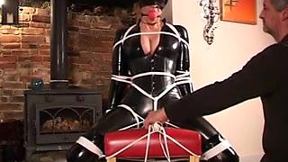 Catsuit clad and bound up in trunk
