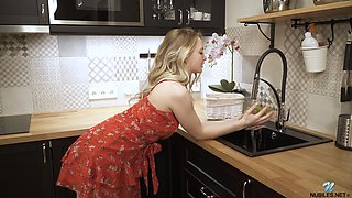 Cutest blond housewife Sophie is masturbating pussy on the table