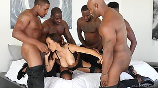 Sex queen Lisa Ann is fucked and jizzed by several insatiable black guys