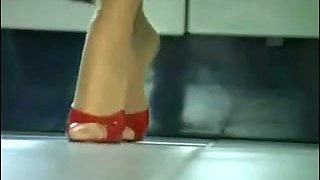 My sensual lover teases me with her feet and high heels