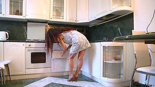 Slim housewife Anee Ocean oils up her pussy and enjoys masturbating in the kitchen