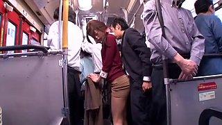 Japanese whore sucks dick in a public bus