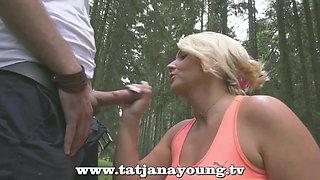 busty german milf blows outdoor
