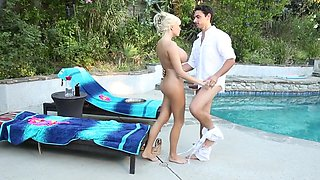 Two lovers are having some fun in their swimming pool