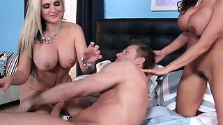 Busty wife and mistress share a cock together