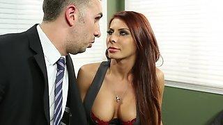 Redhead secretary bends over boss's desk to receive his pecker