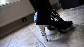 Sexy slender dominatrix in lingerie punishes her horny slave