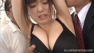 Busty Japanese milf Yua Kuramochi enjoys a gangbang in a bus
