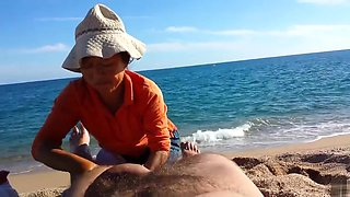Older Asian bitch massages a guy's hairy legs admiring his big cock