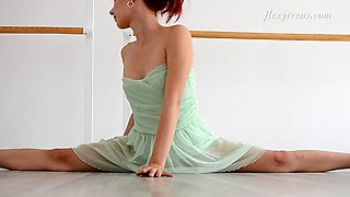 Russian redhead decides to stretch out her naked body for the camera