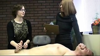 Nerdy amateur babe puts her skillful hands to work on a dick