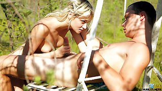 Young couple having sex in the woods in the middle of the day