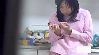 Asian gets masturbation orgasm on the kitchen floor