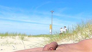 Nudist beach sunbathing, flashing