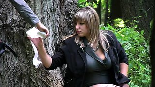 Voyeur spies on a curvy amateur babe pissing in the woods