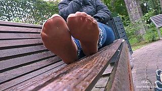 Cute Soles In Sweaty Nylon Socks Outdoors On A Rainy Day