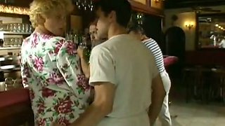 Big boobed blondie meets a guy at the bar and takes him home
