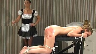Oiled girl gets her firm ass punished by a naughty maid