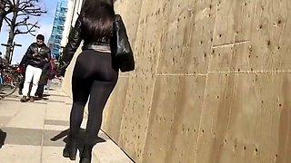 Beautiful arabic girl walking on the street (extended)