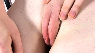 Voluptuous redhead honey gets naked on cam