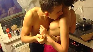 Amateur brunette gets undressed and fucked hard in the kitchen