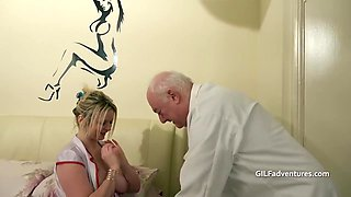 Fat Older Doctor With A Younger Nurse