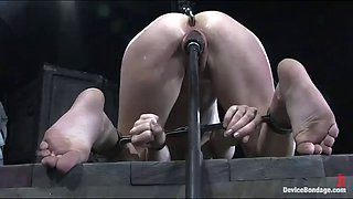 bondage scene with a sexy and kinky brunette