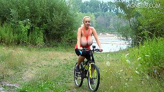 BIG TITS on the bike