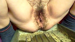 Hairy mother pisses in bed