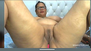 Mature brunette Dina shows pussy and monster boobs