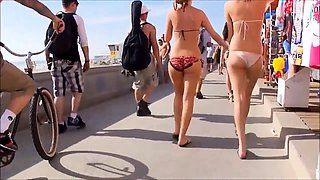 Slender bikini babe with a wonderful ass enjoys the hot sun