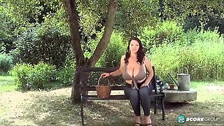 Joana Bliss is a busty brunette who likes to display her milk jugs and play with pussy