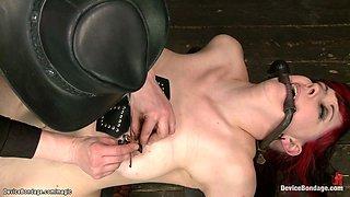 Lesbian in back arch device bondage