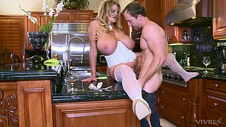 Kelly Madison likes to ride and blow a friend's penis in the kitchen