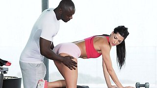 BBC loving babe enjoys oral while anally pounded in gym