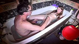 Petite young babe used by a horny old pervert in the bathtub