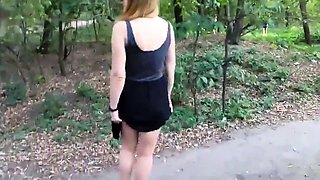 Girl walks in the Park with naked booty