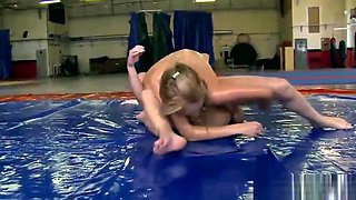 Hot wrestling lesbians oiled up and naked