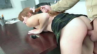 Horny teacher catches pigtailed coed and fucks her on the table