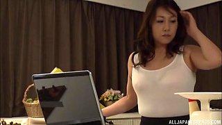 Solo Japanese wife Kondou Ikumi pleasures her pussy in the kitchen